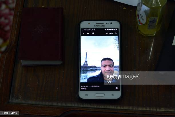 TOPSHOT A picture taken on February 5 shows a picture of Abdallah ElHamahmy an Egyptian suspected of being the machete attacker in Paris's Louvre...