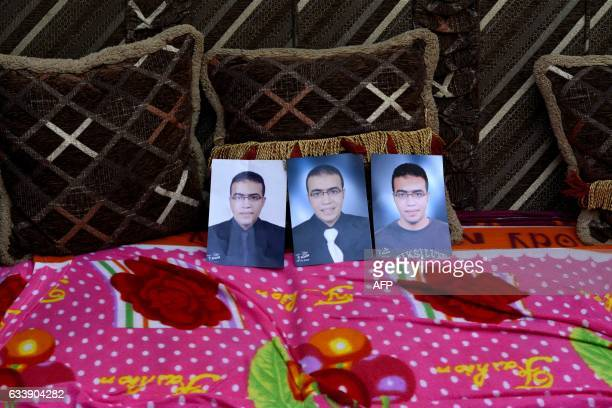TOPSHOT A picture taken on February 5 shows portraits of Abdallah ElHamahmy an Egyptian suspected of being the machete attacker in Paris's Louvre...