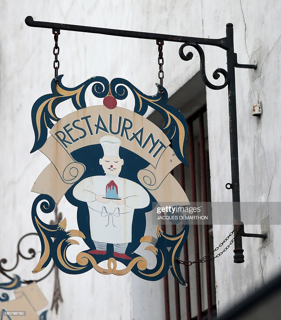 A picture taken on february 6, 2013 in Paris, shows the sign of a restaurant.