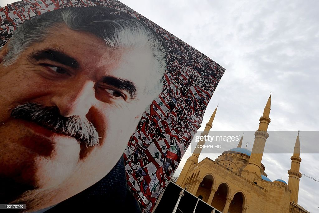 A picture taken on February 6, 2015 in central Beirut shows a giant poster bearing a portrait of slain Lebanese prime minister <a gi-track='captionPersonalityLinkClicked' href=/galleries/search?phrase=Rafiq+Hariri&family=editorial&specificpeople=549773 ng-click='$event.stopPropagation()'>Rafiq Hariri</a> on the tenth anniversary of his death. 'Ten years, 100 years, 1,000 years, we will stay faithful to you' read the billboards going up around Beirut a decade after Lebanon was upended by Hariri's assassination. AFP PHOTO / JOSEPH EID