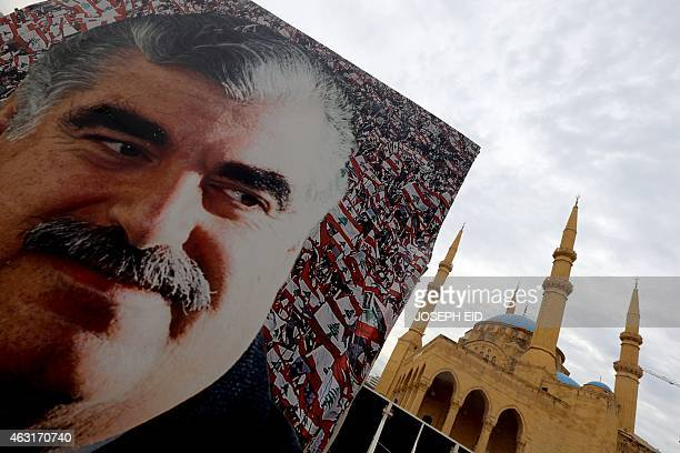 A picture taken on February 6 2015 in central Beirut shows a giant poster bearing a portrait of slain Lebanese prime minister Rafiq Hariri on the...