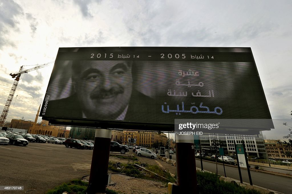 A picture taken on February 6, 2015 shows a billboard with a portrait of slain Lebanese prime minister <a gi-track='captionPersonalityLinkClicked' href=/galleries/search?phrase=Rafiq+Hariri&family=editorial&specificpeople=549773 ng-click='$event.stopPropagation()'>Rafiq Hariri</a> displayed in central Beirut on the tenth anniversary of his death. 'Ten years, 100 years, 1,000 years, we will stay faithful to you' read the billboards going up around Beirut a decade after Lebanon was upended by Hariri's assassination.
