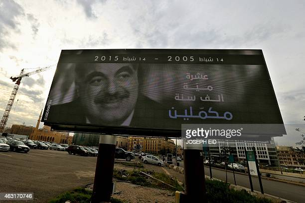 A picture taken on February 6 2015 shows a billboard with a portrait of slain Lebanese prime minister Rafiq Hariri displayed in central Beirut on the...