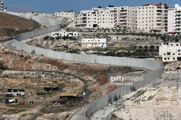 A picture taken on February 6 2017 shows Israel's controversial separation barrier dividing east Jerusalem from the West Bank village of Anata / AFP...