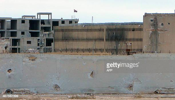 A picture taken on February 6 shows the Aleppo central prison during clashes between proSyrian regime soldiers and rebel fighters Syrian troops...