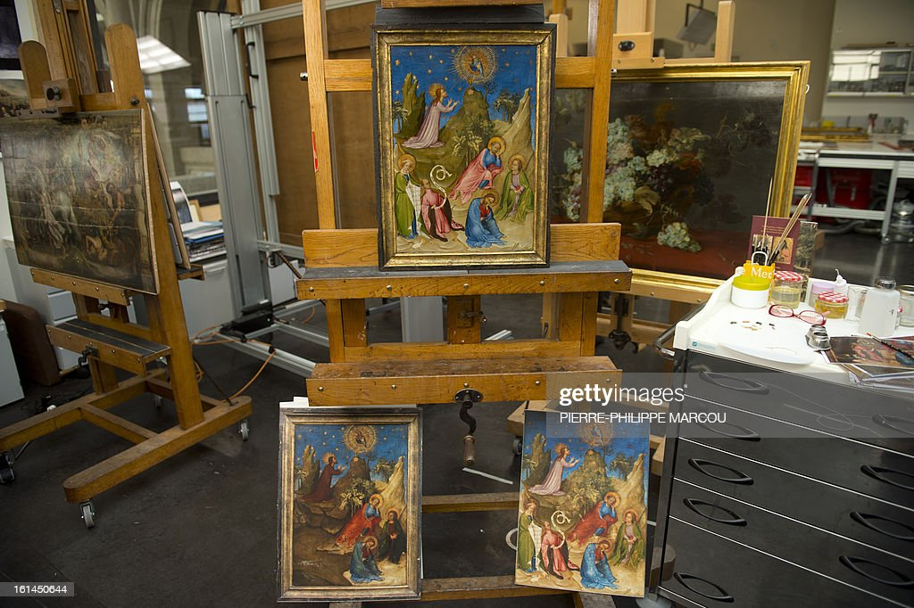 A picture taken on February 7, 2013 shows the restored painting 'Oracion en el huerto' (Agony in the Garden) (Above) supposedly by painter Colart de Laon at El Prado museum in Madrid on February 7, 2013. Spain's Prado art museum on February 11, 2013 unveiled a previously unseen jewel of French painting in which experts found a rare image of the historic French ruler Louis of Orleans.