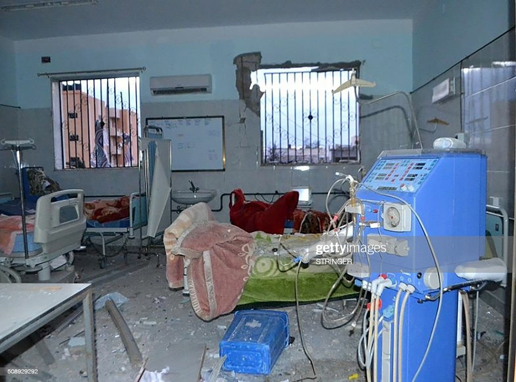 A picture taken on February 7, 2016 shows the damage in a room following a reported air strike on a hospital in Derna, 100 kilometres (680 miles) east of the capital Tripoli, killing four people including a woman and her child and two anti-government fighters, a doctor said. In a statement, the Mujahedeen Shura Council said the attack was in the area of the Faculty of Medical Technology Science in the Bab Tobruk district of eastern Derna. The Mujahedeen Shura Council of Derna is a coalition of Islamist militias in the city. / AFP / STRINGER