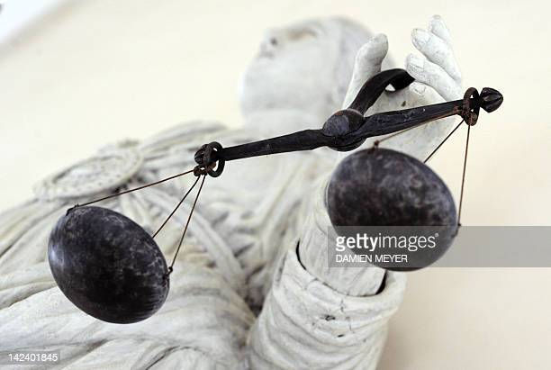 A picture taken on February 8 2011 in Rennes western France shows a marble statue representing Themis the Goddess of Justice at Brittany parliament...