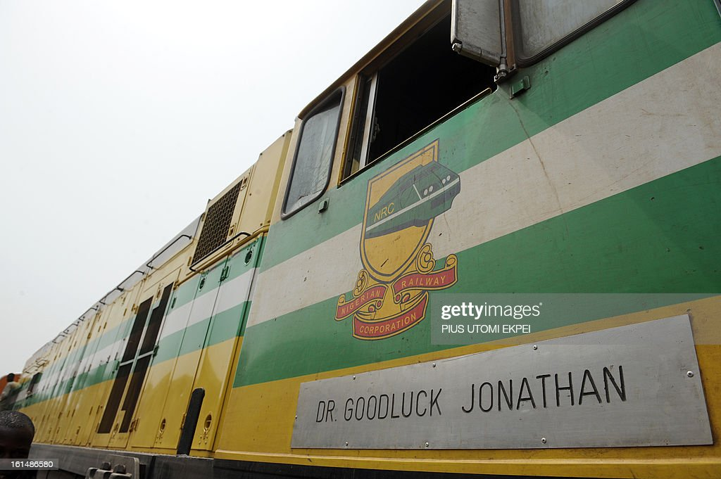 A picture taken on February 8, 2013 in Minna shows a locomotive of the Nigerian Railway Corporation dedicated to President Goodluck Jonathan . The rejuvenated Nigerian Railway Corporation has resumed passenger and haulage services on the Lagos-Kano route following the refurbishing of engines and coaches over 20 years the corporation had gone bankrupt. Earlier last year, the corporation had acquired 20 pressurised tank wagons in preparation for the haulage of petroleum products from Lagos to northern parts of the country. The 20 wagons have the capacity to lift 900,000 litres of petroleum products, the equivalent of 27 road tankers. AFP PHOTO/PIUS UTOMI EKPEI