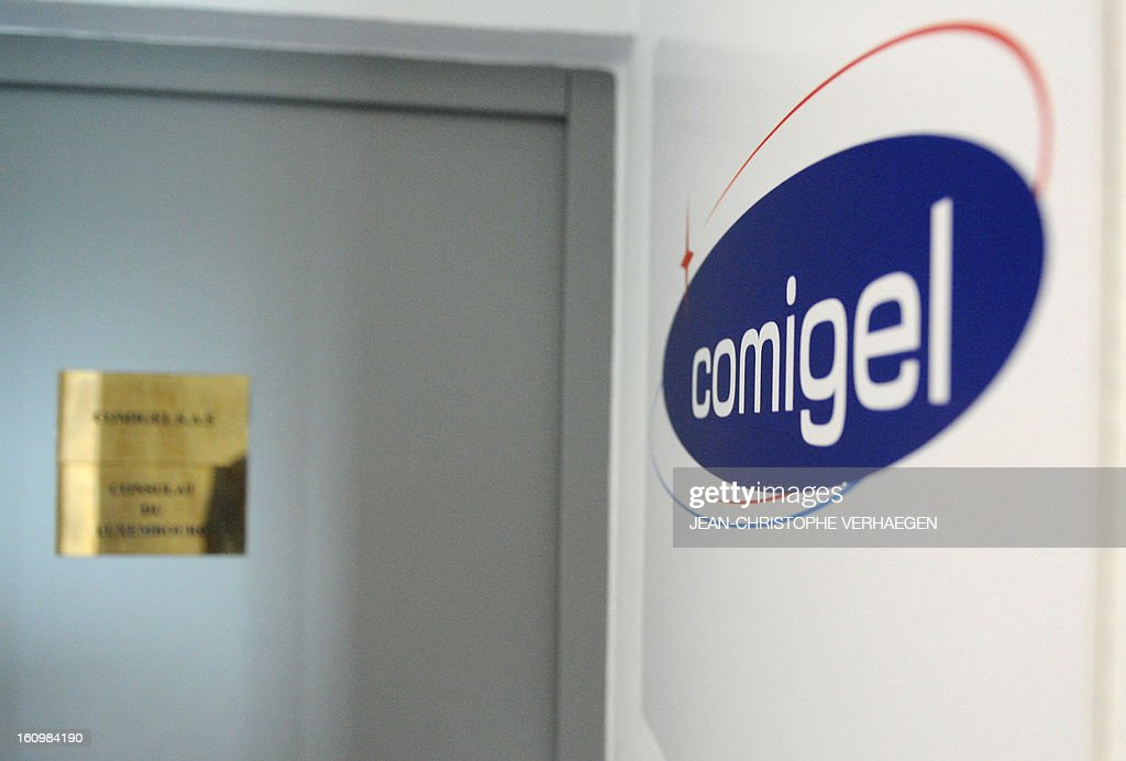 A picture taken on February 8, 2013 shows the logo and the entrance door of the Comigel company in Metz, eastern France. The French food company that supplied frozen lasagne found to contain up to 100 percent horsemeat to British supermarkets today shut down its website and declined to answer media enquiries. Comigel, based in the northern city of Metz, supplies frozen meals to supermarket chains and other clients in 15 countries, with Germany, the Netherlands, Belgium and Scandinavia the main markets, according to industry websites. AFP PHOTO / JEAN-CHRISTOPHE VERHAEGEN
