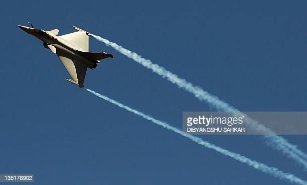 A picture taken on February 9 2011 shows a French Dassault Rafale multirole combat aircraft performing during the Aero India 2011 inauguration day at...