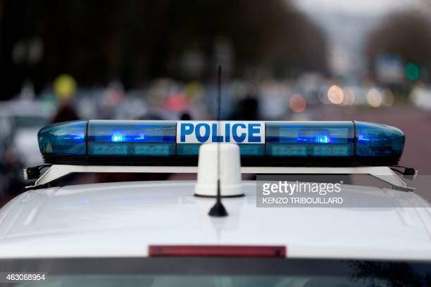 A picture taken on February 9 2015 in Paris shows the emergency light of a police car AFP PHOTO / KENZO TRIBOUILLARD