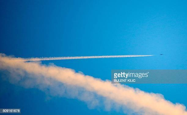 TOPSHOT A picture taken on February 9 2016 in Kilis shows an unknown jet fighter flying over Syria More than a million Syrians are living under...