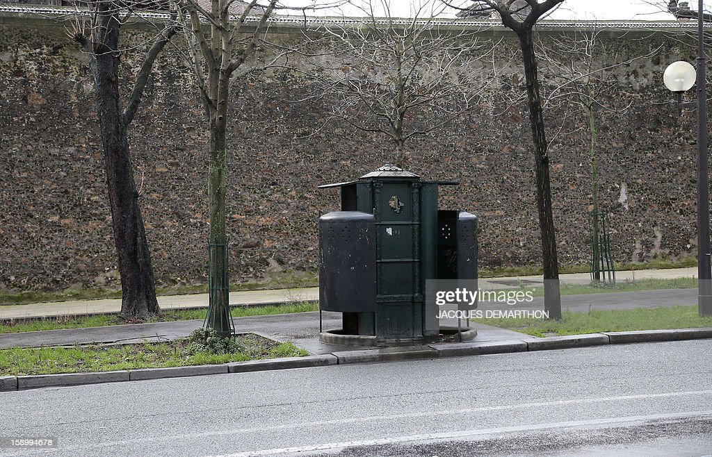 A picture taken on January 1, 2013 shows a 'Vespasienne' (from Vespasian, the Roman emperor who introduced a tax on public lavatories), a public street urinal for men located in the 14th district of Paris. AFP PHOTO/JACQUES DEMARTHON