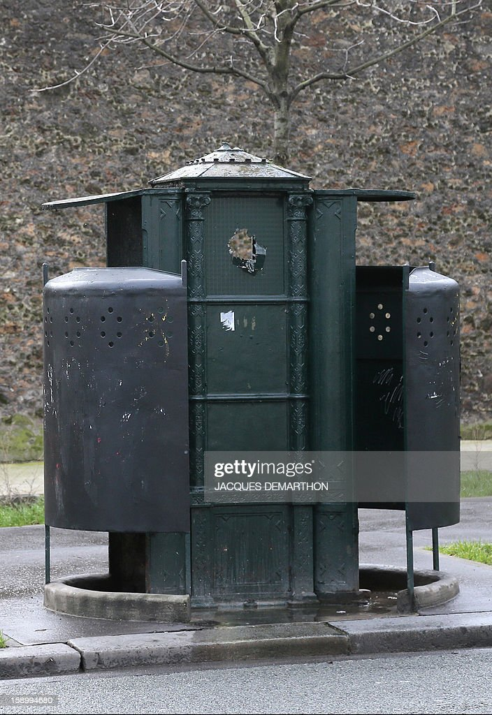 A picture taken on January 1, 2013 shows a 'Vespasienne' (from Vespasian, the Roman emperor who introduced a tax on public lavatories), a public street urinal for men located in the 14th district of Paris.