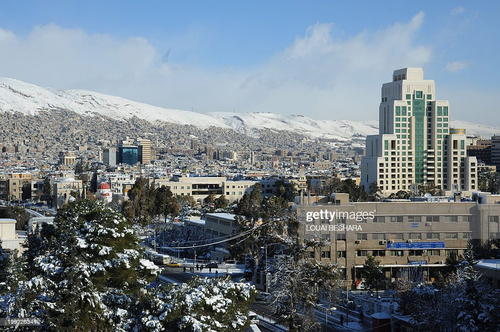 A picture taken on January 10, 2013 shows of general view of the Syrian capital of Damascus after heavy snow falls. Snow carpeted Syria's war-torn cities but sparked no let-up in the fighting, instead heaping fresh misery on a civilian population already enduring a chronic shortage of heating fuel and daily power cuts. AFP PHOTO / LOUAI BESHARA