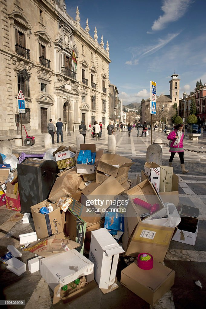 A picture taken on January 11, 2013 shows uncollected rubbish in a street of Granada. Rubbish collectors have been on strike in the municipality of Granada to protest against the austerity cuts imposed by the town hall.