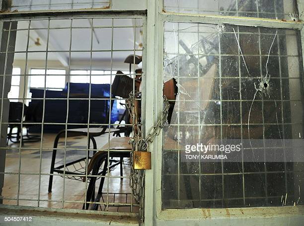 A picture taken on January 11 2016 shows a padlocked facility with bullet shattered windowpanes at Garissa university college after it reopened...