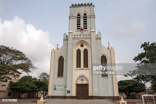 A picture taken on January 11 2017 shows a general view of the Basilica of the Immaculate Conception in the small coastal town of Ouidah some 40km...