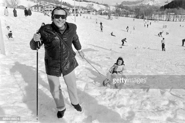 A picture taken on January 11 in Megeve shows late French actor JeanMarc Thibault pulling his son Alexandre in a sled Thibault who formed Roger...
