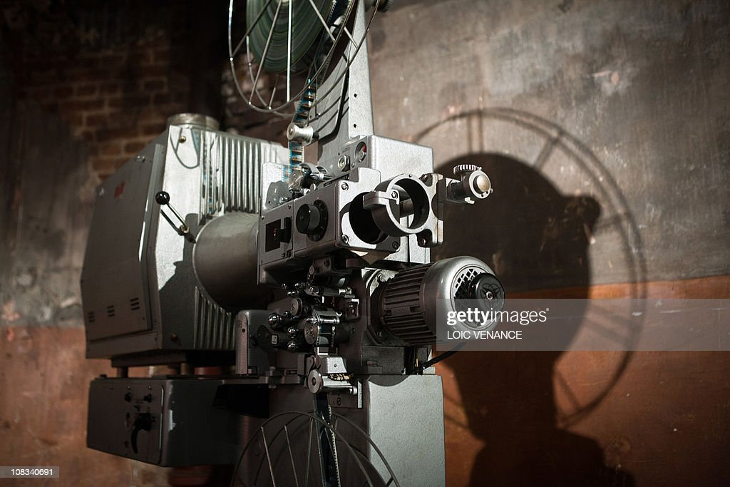 A picture taken on January 12, 2011 in Paris shows a film projector in the 'Cinema des Cineastes' movie theater.