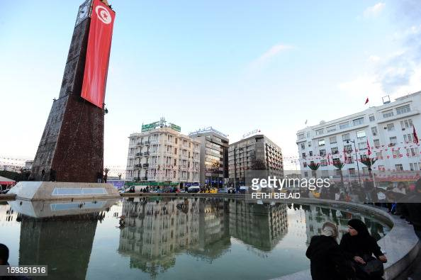 A picture taken on January 12 2013 on the Habib Bourguiba avenue in Tunis shows the big clock covered with a national flag as part of the festivities...