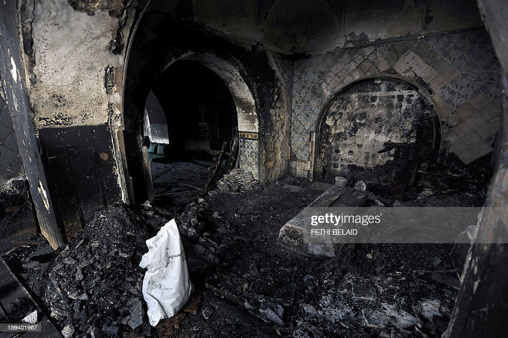 A picture taken on January 13, 2013 in Sidi Bou Said shows a mausoleum ravaged by fire in what is thought to have been an arson attack which the presidency denounced as a criminal act. Several shrines dedicated to Muslim saints have been torched or looted in recent months in Tunisia, in acts blamed on hardline Salafists whose radical version of Sunni Islam does not tolerate saints or shrines.