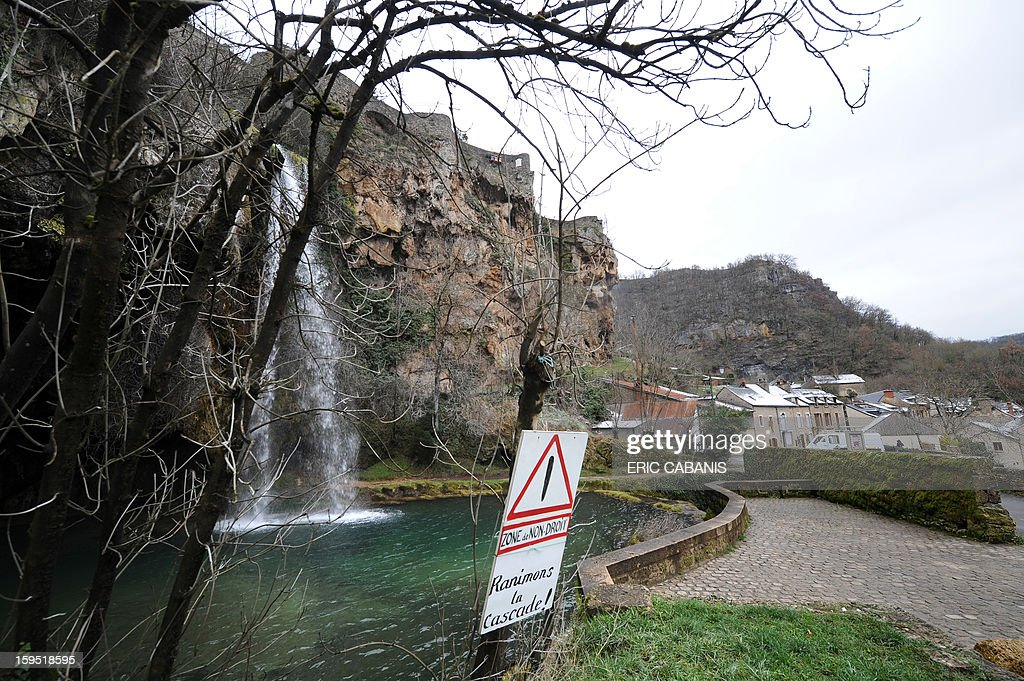 A picture taken on January 14, 2013 shows the waterfall in the center of Salles-la-Source, southern France. AFP PHOTO / ERIC CABANIS