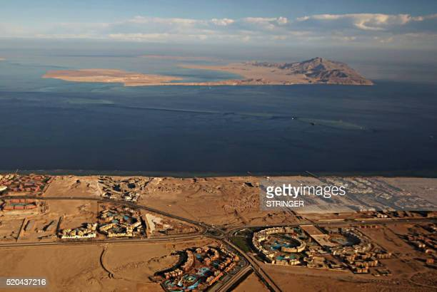 A picture taken on January 14 2014 through the window of an airplane shows the Red Sea's Tiran and the Sanafir islands in the Strait of Tiran between...