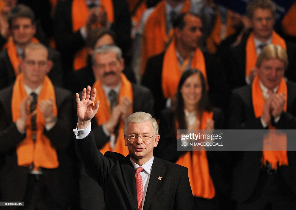 FILES - Picture taken on January 15, 2009 shows Hessen Premier Roland Koch waving after addressing an election rally of the Christian Democratic Union (CDU) in Frankfurt/Main, western Germany, ahead of regional elections in Hessen. Koch, a powerful rival of German Chancellor Angela Merkel and a big-hitting regional baron in her party announced his surprise resignation on May 25, 2010, but denied it was due to any spat.