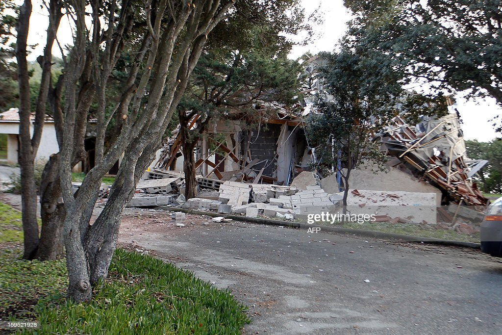 Picture taken on January 15 2013 at a holiday camp in Olmeto of a of the wreckage of a bungalow destroyed by a bomb attack earlier today The attack...