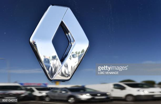 A picture taken on January 15 2016 in SaintHerblain western France shows the logo of carmaker Renault on one of its cars A governmentappointed...