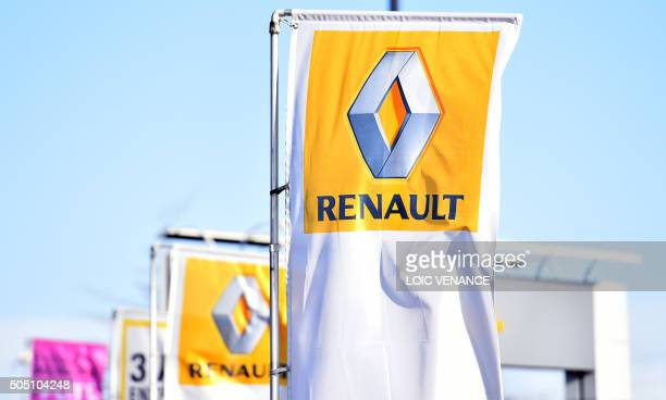 A picture taken on January 15 2016 in SaintHerblain western France shows the logo of carmaker Renault on flags A governmentappointed commission said...