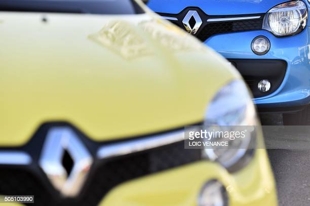 A picture taken on January 15 2016 in SaintHerblain western France shows two Renault cars on a parking A governmentappointed commission said on...