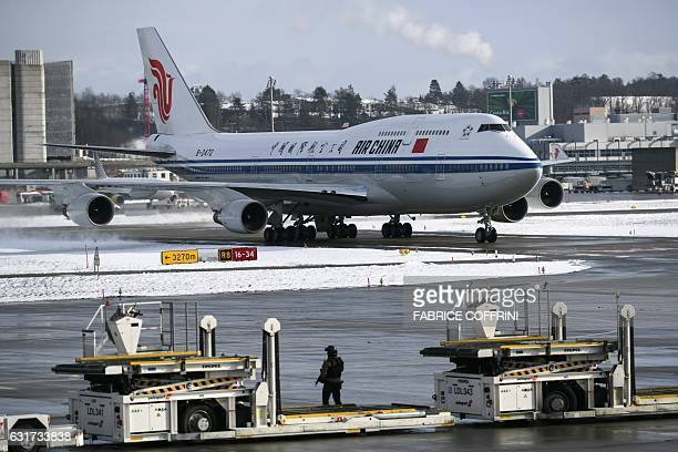 A picture taken on January 15 2017 shows the plane carrying Chinese president Xi Jinping for a state visit after landing at Zurich Airport Xi Jinping...