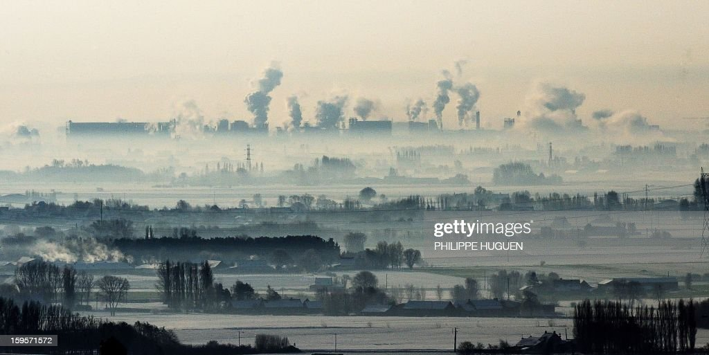 A picture taken on January 16, 2013 in Lestrem, northeastern France showing smokes coming out from Roquette's factory chimmeys.