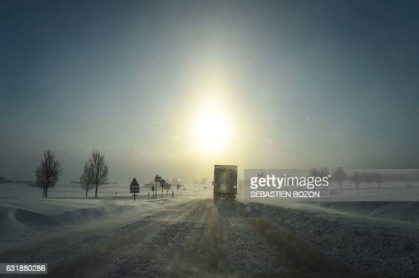 TOPSHOT A picture taken on January 17 2017 shows a truck on a snow covered road in Mouthe also dubbed 'Petite Siberie' is renowned as the coldest...