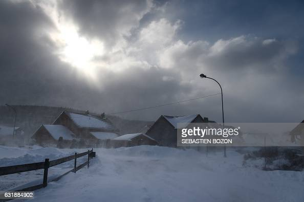 TOPSHOT A picture taken on January 17 2017 shows several snowcovered houses in the city of Mouthe also dubbed 'Petite Siberie' renowned as the...