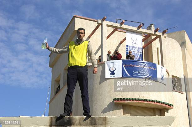A picture taken on January 18 2012 shows Abdelwahab Zeidoun a young Moroccan unemployed man holding a bottle of petrol near an education ministry...