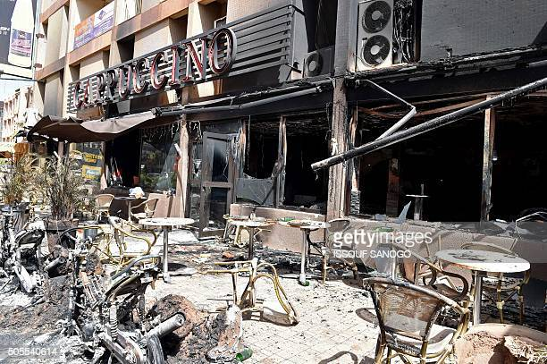 A picture taken on January 18 2016 shows the damage outside the Cappuccino cafe in Ouagadougou following a jihadist attack by AlQaeda in the Islamic...