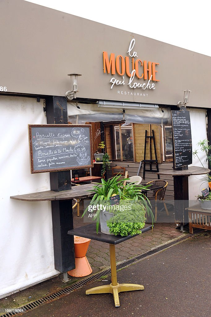 A picture taken on January 19, 2013 in Anglet, in southwestern France shows the entrance of the restaurant 'La mouche qui louche', owned by French citizen Yann Desjeux, killed in the hostage rescue operation at a remote gas plant seized by Islamist militants in Algeria. Yann Desjeux, 52, was a former member of the French special forces at the 1st RPIMA in Bayonne, in southwestern France.
