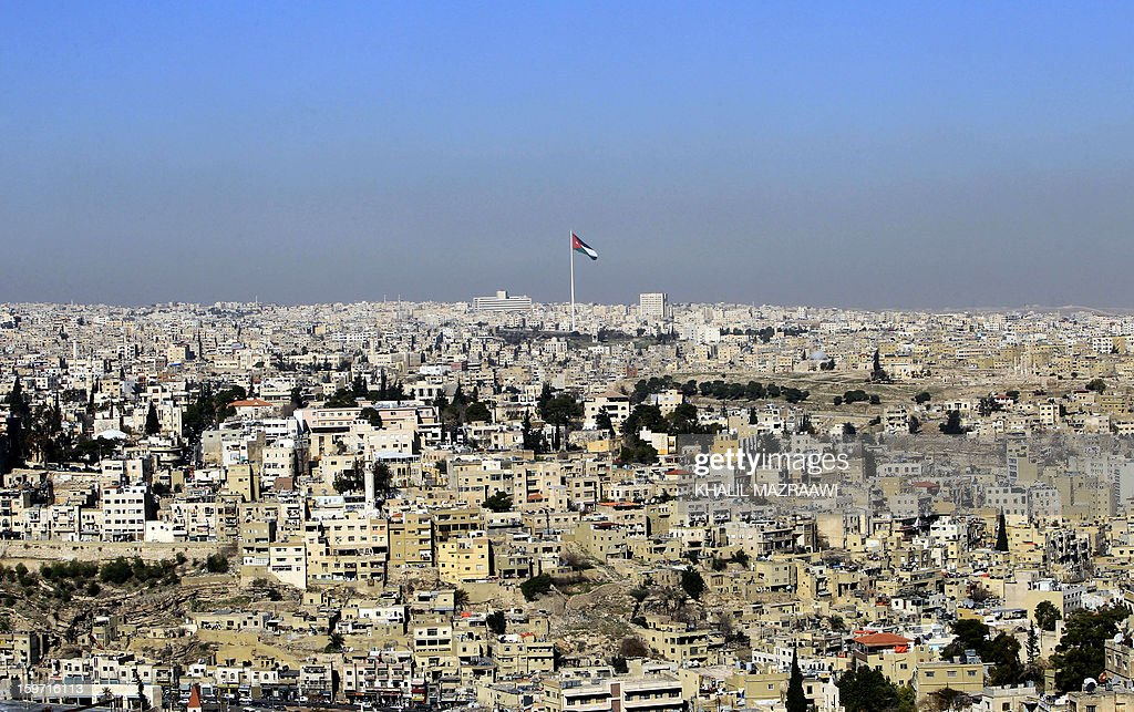 A picture taken on January 19, 2013, shows the Jordanian flag flying in the capital Amman as the country prepares for parliamentary elections. More than 1,500 candidates, including 213 women, have been registered for the January 23 election, which the opposition Islamists and other groups have boycotted over a lack of reform. AFP PHOTO / KHALIL MAZRAAWI