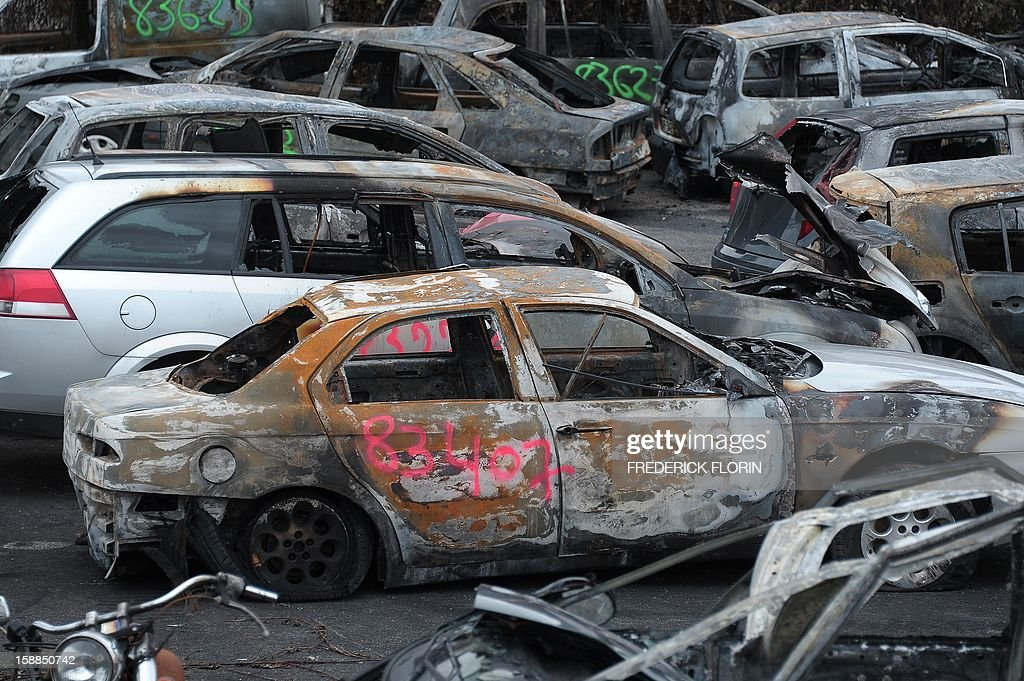 A picture taken on January 1st, 2013 shows burnt cars collected by city employees during the New Year's eve in Strasbourg, eastern France. AFP PHOTO/FREDERICK FLORIN