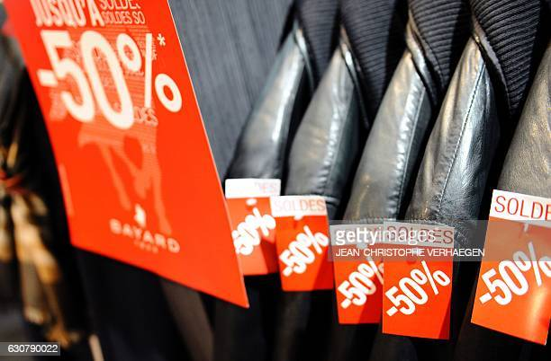 A picture taken on January 2 2017 shows sales tags on clothing at a mall in Talange eastern France on the first day of the regional winter sales a...