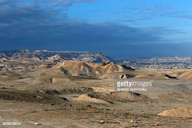 A picture taken on January 20 2016 shows a view of the mountains of the Judean desert and the West Bank city of Jericho / AFP / AHMAD GHARABLI