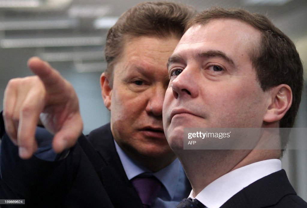 A picture taken on January 21, 2013 shows Russia's Prime Minister Dmitry Medvedev (R) speaking with Gazprom CEO Alexei Miller during their visit to the recently built Adler thermal power plant in the Russian Black Sea resort of Sochi. The 360 MW Adler thermal power plant will be one of the main sources of power for the coastal cluster of the Sochi 2014 Olympic venues. AFP PHOTO/RIA-NOVOSTI/POOL/MIKHAIL MOKRUSHIN