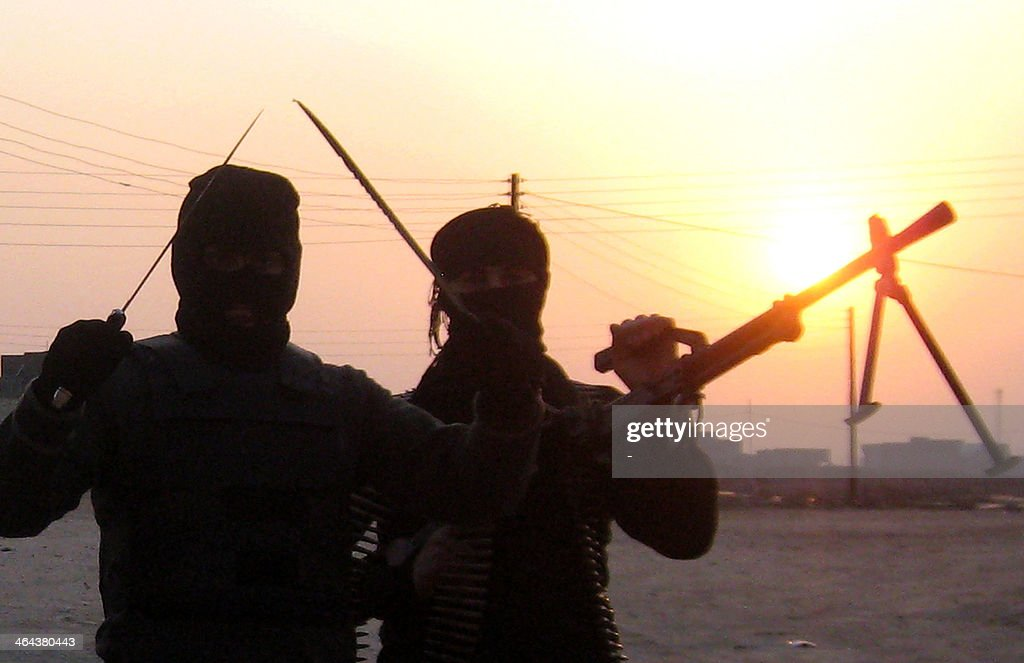 A picture taken on January 21 2014 shows antigovernment fighters posing for a photograph as they take position during clashes with Iraqi security...