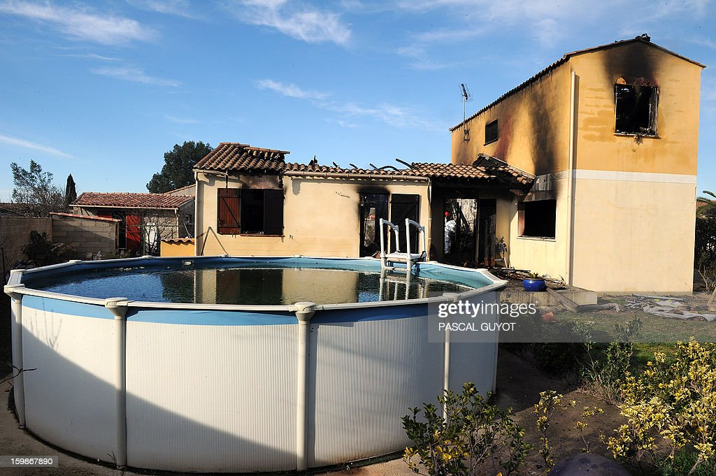 A picture taken on January 22, 2013 in Garons, near Nimes, southern France, shows a swiming pool in the garden of a house where five people were found dead. The bodies of two adults and three children were found by firemen after a neigbour called for a fire in the afternoon.