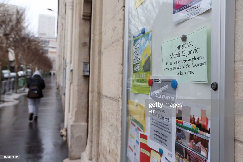 A picture taken on January 22, 2013 shows an information sign at the entrance of a primary school in Paris, on the first day of a strike in Paris' schools called by French educational trade unions to protest against French Education Minister's project to turn back to a 4,5-day work-week for the 2013-2014 schoolyear.