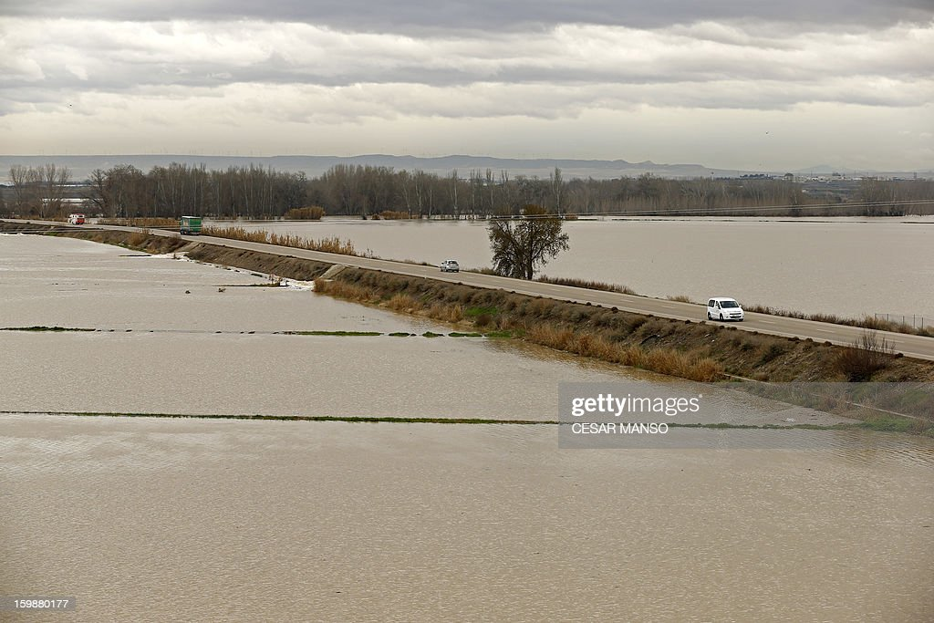 A picture taken on January 22, 2013 shows flooded areas surrounding the A-126 highway, linking Boquianeri to Novillas, near Zaragoza, following the rise of the River Ebro due to heavy rainfall. AFP PHOTO/ CESAR MANSO